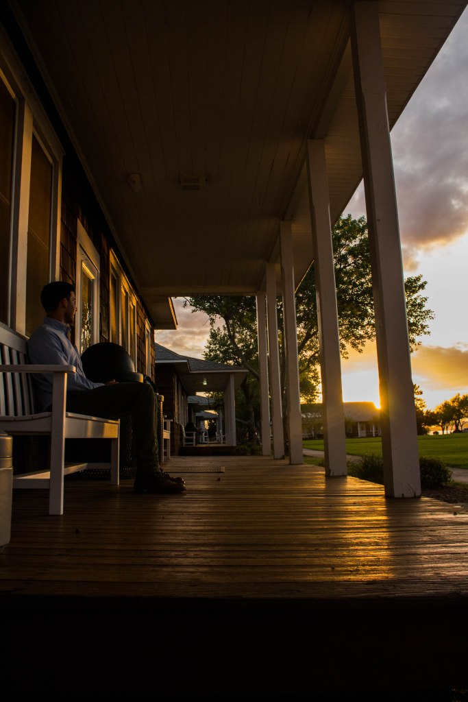 Ryan Huang: Everyone always loves a good sunset, and while walking hanging out with friends at the Duke University Marine Lab, I could not pass up the opportunity to take a shot. Here, my friend Chase is sitting on one of the plethora of porches chilling after a long day of conference talks, enjoying the sunset as the day winds down.